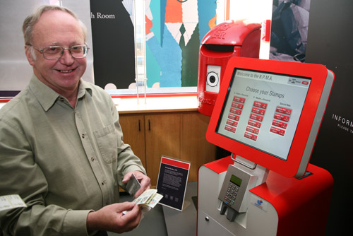 Douglas Muir, BPMA Curator of Philately, is the first official user of the Royal Mail's Post and Go machine, newly installed in the foyer of the British Postal Museum & Archive.