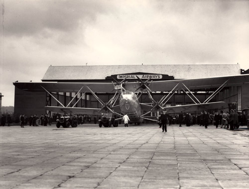 Tractors towing Hengist out of the Imperial Airways' hangar at Croydon, prior to the first service to Australia. (POST 118/201)