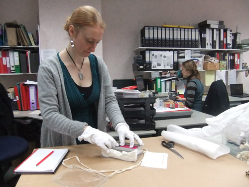 BPMA Curator Emma Harper prepares Sergeant Alfred Knight's Victoria Cross for transport to the event.