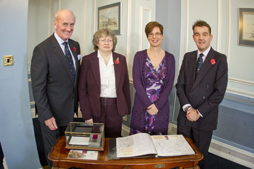 Amongst those posing with the Victoria Cross are (left to right) Anne Walsh (Sgt Knight's grand-daughter), Ann Turrell (Post Office) and Col Stephen Heron (BFPO).