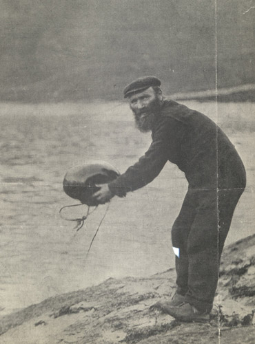 "A St Kilda islander launches a ""mail boat"". (Early 20th Century)"