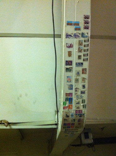 Stamps stuck to the trunking near the mail chute, Mail Rail Mount Pleasant.