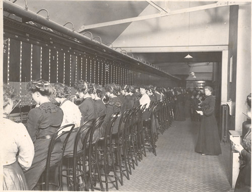 Row of telephonists sitting at manual switchboard, Holborn, 1904. (POST 118/114)