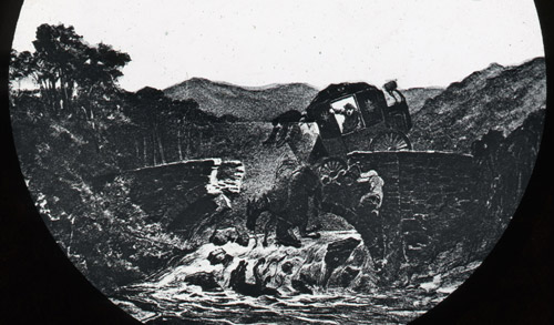 Accident, Lanark. Detail of a lantern slide showing a scene of a broken bridge where there central portion of the span has fallen into the river below. A coach is hanging off the right hand edge with two horses dangling in their harness. (2012-0139/1)