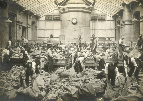 Men sorting bags of parcels. (POST 56/6)