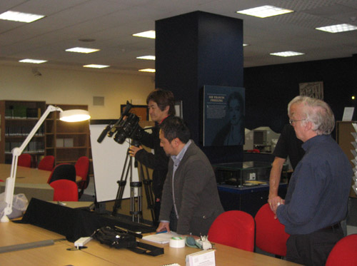 Philatelic Curator Douglas Muir (right) with the Japanese film crew.