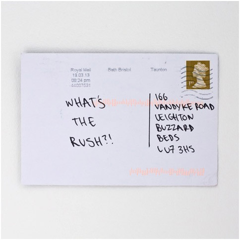 """Postcard showing the message """"What's the Rush!!""""."""