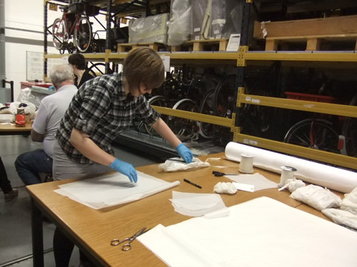 Flora auditing and packing the museum collection.