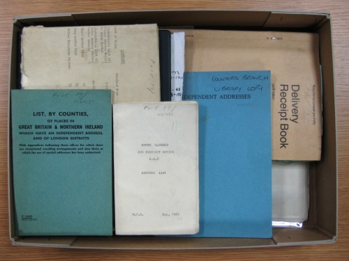 A box of letter sorting manuals.
