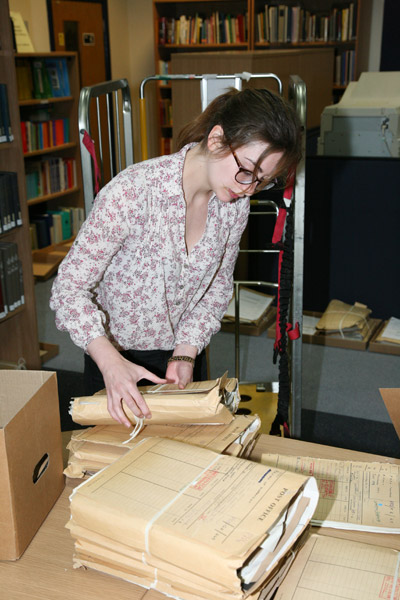 Archives Assistant, Penny McMahon, assisting with the Second Review audit and reboxing.