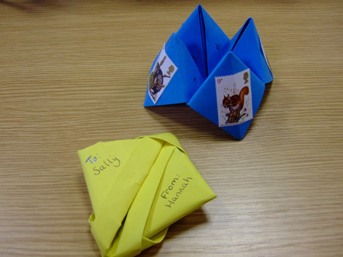 Have a go at making your own folded letter or origami fortune teller.
