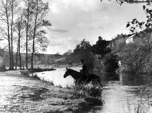 Postman on horseback near Withypool, Somerset, 1938. (POST 118/910)