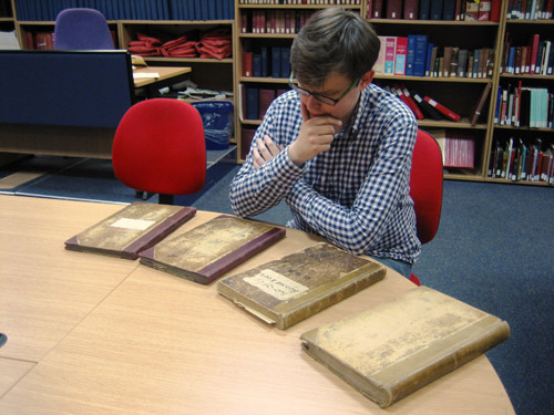 Matt inspects the record books in the BPMA Search Room.