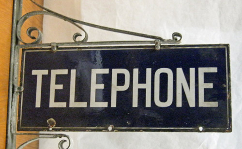 Telephone sign. (OB2001.39/2)