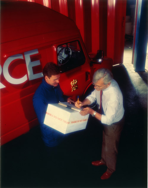 A parcel delivery to Pilkington Glass at St. Helens, Merseyside, one of Parcelforce's major contract customers. Image used in The Post Office Reports and Accounts, 1989-1990. (010-005-001)