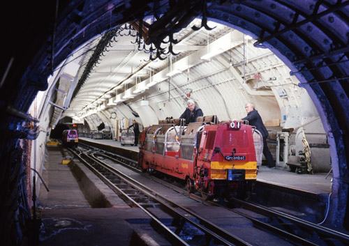 Loading a Mail Rail locomotive at the platform, taken from the tunnel, 1969. (POST 118/CT00357)