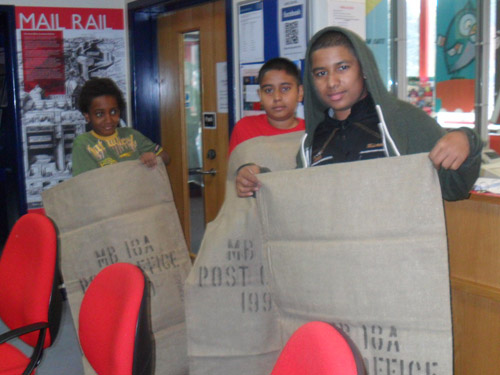 The group were shocked to find the mail bags were almost as big as them!