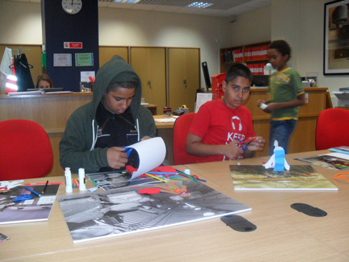 The budding archivists at work on their collages.