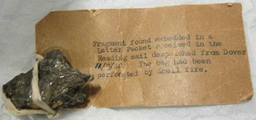 Frament of shrapnel found embedded in a Letter Packet received in the Reading mail despatched from Dover, 11 September 1940. The bag had been perforated by shell fire. (2002-0953)