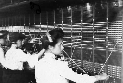 Central Telephone Exchange - telephone operators at a telegraph board (2010-0412/2). Telephones were once under the control of the General Post Office.