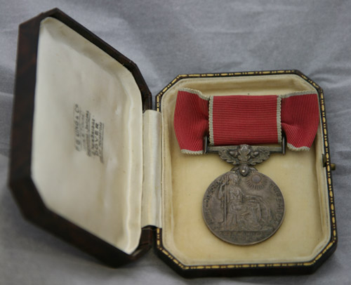 Medal awarded to Miss W Scanlan during World War II for bravery during bombing raids on the Telephone Exchange at Dover. (2004-0024/01)