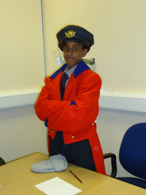 A student takes on the role of 1700s letter carrier/GPO postman.