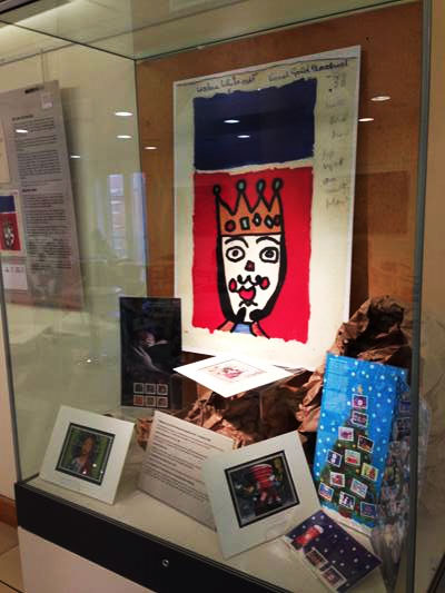 An exhibition case at Beverley Art Gallery features the first Christmas stamp designed by children.