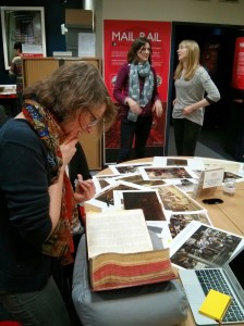 Even us 'non-experts' jumped in. Alex, Project Officer at Historypin, looks through a resource from our archive. Photo credit: Historypin