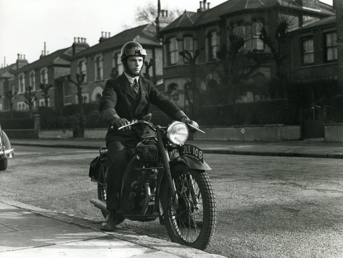 A glimpse of the vast photographic collection of POST 118: a junior postman on a motorcycle (POST 118/2040)