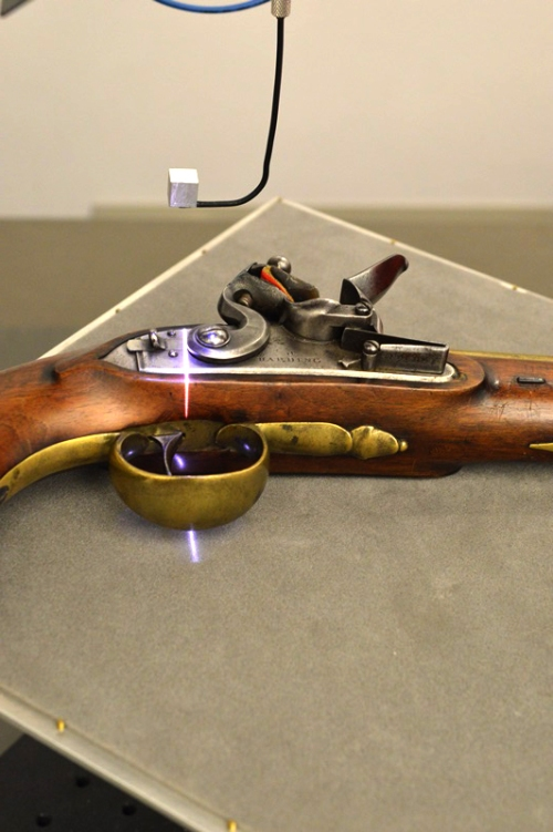 Flintlock pistol being scanned.