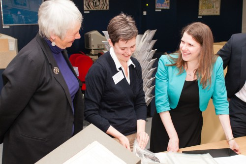 Showing The Rt Hon. Jo Swinson MP, Parliamentary Under Secretary of State for Employment relations, consumer and postal affairs around our search room and archive with current BPMA Chair (left) Dr Helen Forde