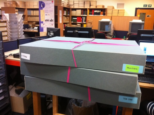 Pink ribbon= objects audited and freshly packed = Productive day
