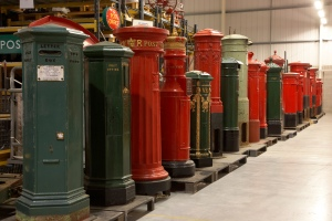 The British Postal Museum Store at Debden, near Loughton, Essex. The line of pillar boxes show the development of post boxes from the earliest trials on the Channel Islands in 1852-3 to the modern day.