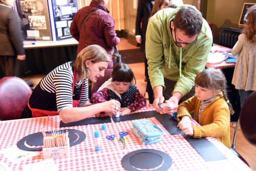 Young visitors make their own Rowland Hill top hats with help from the lovely Natasha from Big Wheel.