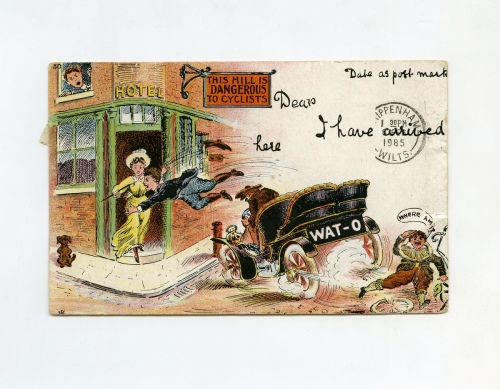 Postcard printed with a comedic scene of a man crashing his car.  Reverse is stamped and bears a message addressed to Miss K. Jenkins. Postmark on reverse is 1905, but on the front the postmark is 1985.