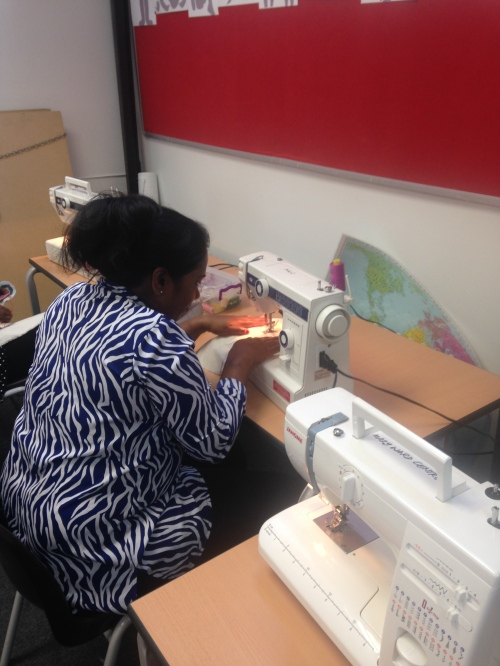 Mani making her bag on the sewing machine